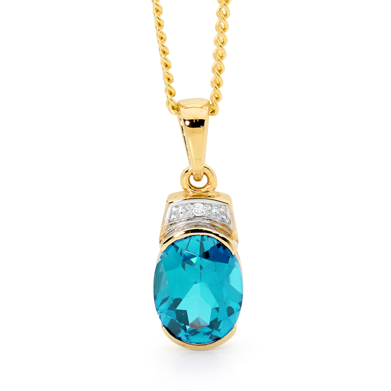 Oval Blue Topaz Pendant with Diamonds