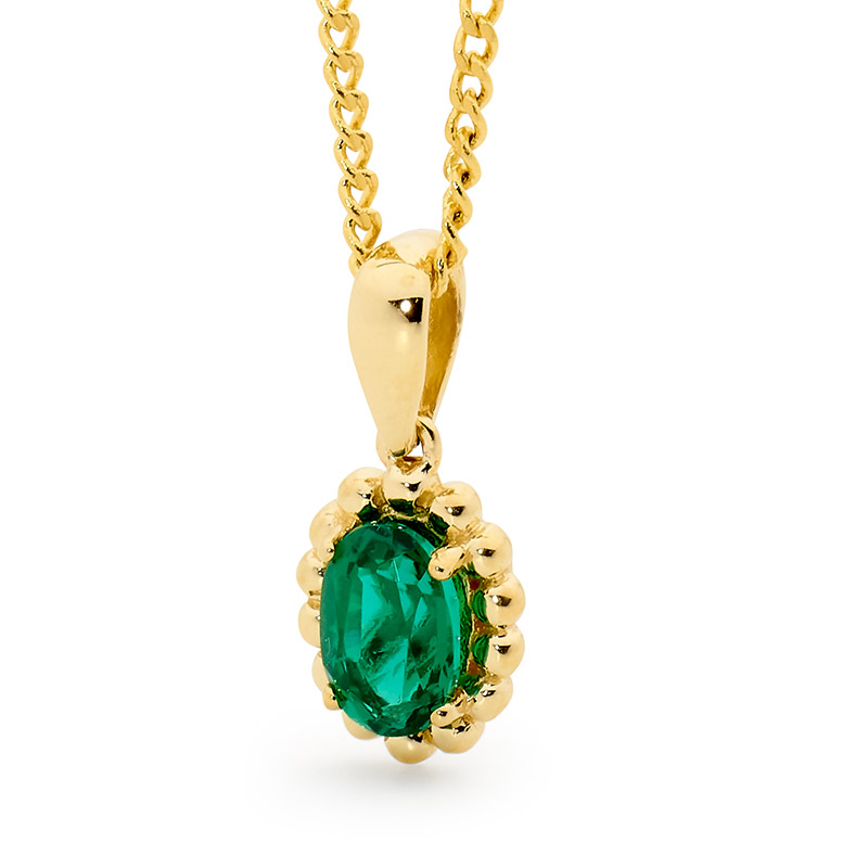 Oval Emerald pendant with Gold Bead Surround